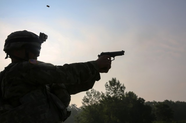 U.S. Army Sgt. Luis Cruz fires a M9 pistol during the 2017 Army Materiel Command's Best Warrior Competition July 18, 2017, at Camp Atterbury, Indiana. The Army's new modular handgun, the XM17 and XM18 will be fielded by the 101st Airborne Division at Fort Campbell, Kentucky, in November.