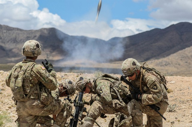 Mortar men from Fort Campbell, Ky., conduct live fire exercise during Network Integration Evaluation 17.2, July 14, at Dona Ana Range Complex, New Mexico. The 2nd Brigade Combat Team, 101st Airborne Division, is the first rotational unit to participate in NIE.