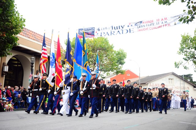 Service Members march in Monterey's Independence Day parade