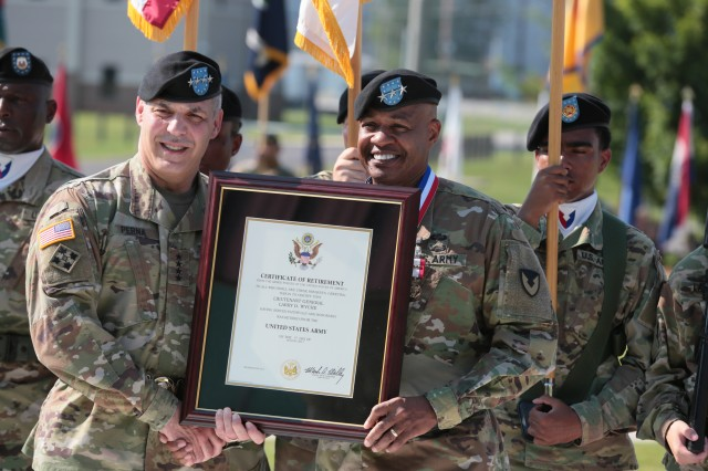Gen. Gus Perna, Army Materiel Command commander, presents Lt. Gen. Larry Wyche, AMC deputy commanding general, with his retirement certificate July 21, officially retiring Wyche after 42 years of service to the U.S. Army.