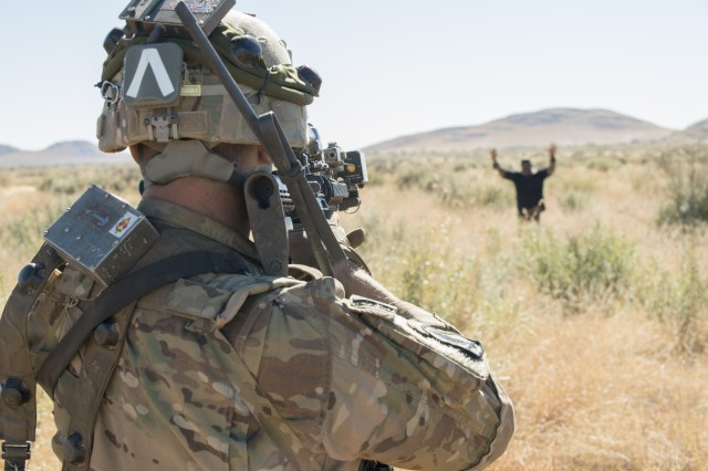 A Soldier with 101st Airborne Division's 2nd Battalion, 327th Infantry Regiment captures a mock insurgent played by a South African soldier during situational training for Shared Accord 17 at the South African Army Combat Training Center in Lohatla, July 21, 2017. The two-week exercise, which ends Aug. 3, enhances the peacekeeping capabilities of U.S. and African forces.