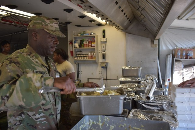 Sgt. David Edwards from the Forward Support Company, 926th Engineer Brigade, ladles cabbage in preparation for the dinner meal at Joint National Training Center, Cincu, Romania, as part of Resolute Castle 17. Sgt. Edwards is one of the senior cooks for Resolute Castle 17, an exercise strengthening the NATO alliance and enhancing its capacity for joint training and response to threats within the region.