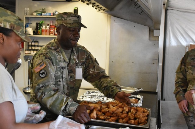 Sgt. David Edwards from the Forward Support Company, 926th Engineer Brigade, changes pans of chicken wings at Joint National Training Center, Cincu, Romania, as part of Resolute Castle 17. Resolute Castle 17 is an exercise strengthening the NATO alliance and enhancing its capacity for joint training and response to threats within the region.