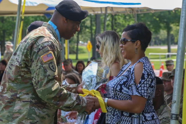 The 10th Mountain Division (Light Infantry) conducted a Mountain Salute ceremony on July 21, at Memorial Park, Fort Drum N.Y., to honor outgoing and incoming deputy commanding generals. A bouquet of yellow roses was presented to Pamela Beagle, the spouse of Col. Milford Beagle, as a token of warm welcome into the 10th Mountain Division family.