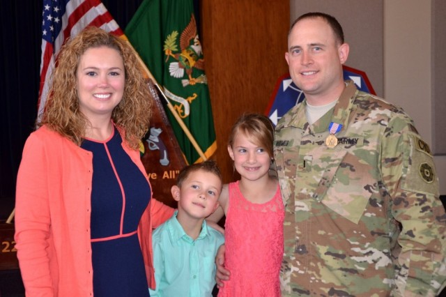 CW3 Jesse Rhymes, right, poses with his wife Sally and their children after receiving the Soldier's Medal at Joint Base Lewis-McChord, Washington, July 13 for saving the life of a man who was trapped inside a burning vehicle.