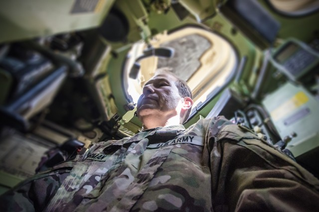 Maj. Gen. Edward Dorman, J-4 (logistics), U.S. Central Command, stands inside a combat configured tank during a tour of an Army Prepositioned Stocks-5 warehouse at Camp Arifjan, Kuwait, July 20. (U.S. Army Photo by Justin Graff, 401st AFSB Public Affairs)