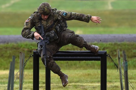 Sgt. Zachary Scuncio, a military police officer with the Rhode Island Army National Guard's 169th Military Police Company, navigates an obstacle while running through the stress shoot event of the 2017 Army National Guard Best Warrior Competition at Camp Ripley, Minn., July 18, 2017.