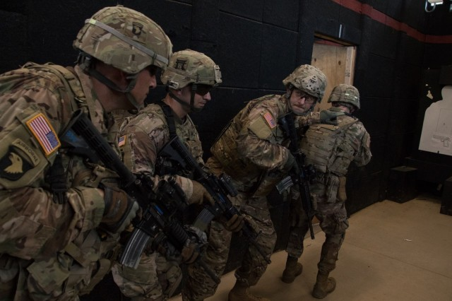 House Speaker Paul Ryan (R-Wisconsin), acting as team leader, and Division Commander Major General Andrew Poppas, as breach man, clear a room in the Urban Warfare Complex, on Fort Campbell, Kentucky, on July 10. The two were joined by two Soldiers from Company C, 2nd Battalion, 506th Infantry Regiment, 3rd Brigade Combat Team, 101st Airborne Division. (Photo by Spc. Patrick Kirby, 40th Public Affairs Detachment)