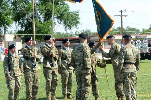 Command Sgt. Maj. Joe Bonds passes the Dugway colors to outgoing commander, Col. Sean G. Kirschner, during the Dugway change of command ceremony, July 12, 2017. Photo by Bonnie Robinson, Dugway Proving Ground Public Affairs.