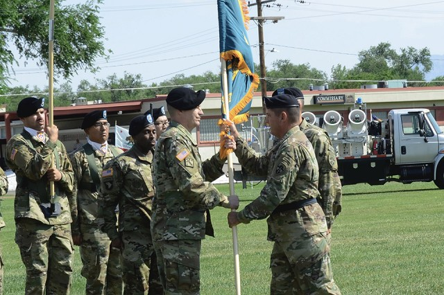Maj. Gen. John W. Charlton passes the Dugway colors to incoming commander, Col. Brant D. Hoskins, during the Dugway change of command ceremony, July 12, 2017. Photo by Bonnie Robinson, Dugway Proving Ground Public Affairs.