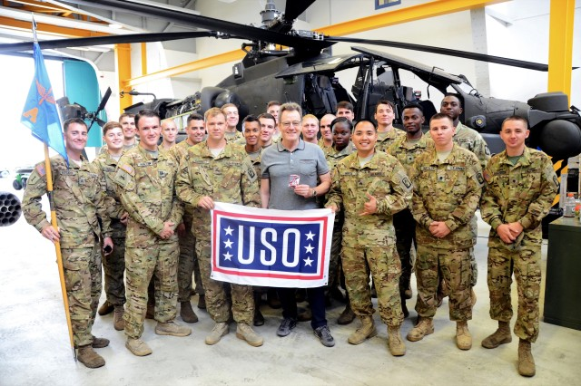 Actor Bryan Cranston stands with Soldiers of A Company, 1st Battalion, 3rd Aviation Regiment (Attack Reconnaissance), for a photo during his visit to Ansbach, Germany, July 24, 2017. (U.S. Army photo by Stephen Baack, USAG Ansbach Public Affairs)