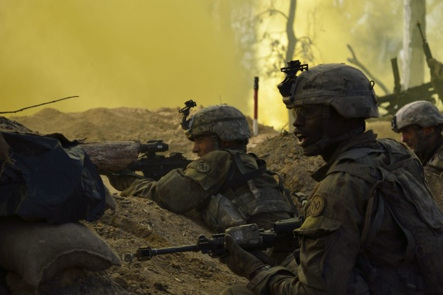 Soldiers from Charlie Company, 1st Battalion 69 Infantry Regiment , New York Army National Guard acting as an opposing force defend their positions during the final battle of Exercise Talisman Saber at the Shoalwater Bay Training Area, Queensland, Australia on July 19, 2017.