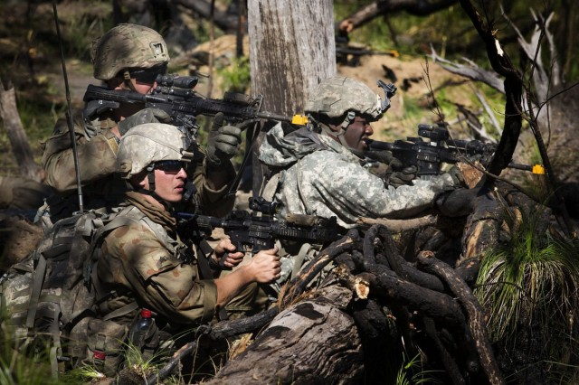 Members of the 1st Battalion 69th Infantry Regiment New York Army National Guard, acting as OPFOR defend their ground against Battlegroup Coral during the final assault at the Shoalwater Bay Training Area during Exercise Talisman Saber on 20 July, 2017.