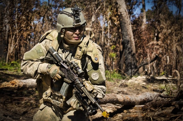 A soldier of the 1st Battalion 69th Infantry Regiment ,New York Army National Guard prepares to face Australian soldiers and US marines as a member of the opposition force during the final assault at the Shoalwater Bay Training Area during Exercise Talisman Saber on 20 July, 2017.