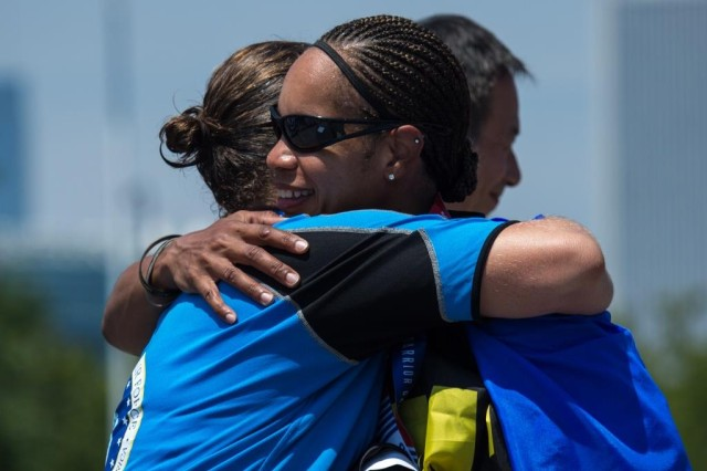 U.S. Army Staff Sgt. Altermese Kendrick wins a gold medal in the cycling event and shares a hug with the silver medal winner during the 2017 Department of Defense Warrior Games at Chicago, Ill., July 6, 2017. The DOD Warrior Games are an annual event allowing wounded, ill and injured service members and veterans to participate in Paralympic-style sports including archery, cycling, field, shooting, sitting volleyball, swimming, track and wheelchair basketball.
