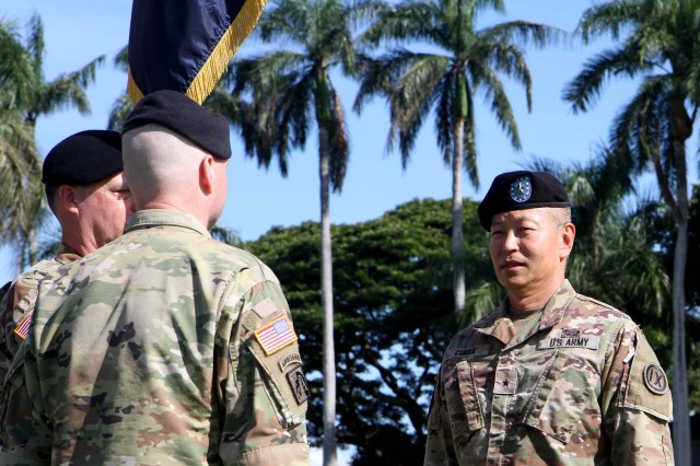 U.S. Army Brig. Gen. Stephen K. Curda, (R) Commanding General, 9th Mission Support Command, U.S. Army Reserve, transfers command to U.S. Army Brig. Gen. Douglas F. Anderson at Fort Shafter, Hawaii July 16, 2017. The 9th MSC held its Change of Command Ceremony, which was hosted by U.S. Army Gen. Robert B. Brown, Commander of U.S. Army Pacific, at historic Palm Circle. The change of command ceremony marks a transfer of total responsibility and authority from one individual to another. (Photo by U.S. Army Staff Sgt. David J. Overson, 305th MPAD)