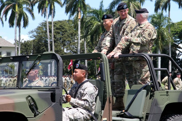 "(L to R), outgoing 9th Mission Support Command, Commanding General, U.S. Army Brig. Gen. Stephen K. Curda, U.S. Army Gen. Robert B. Brown, Commander of U.S. Army Pacific, and incoming 9th MSC CG, Brig. Gen. Douglas F. Anderson, begin to ""Troop the Line,"" which is a way of inspecting an Army unit at the 9th MSC Change of Command Ceremony, at historic Palm Circle, Fort Shafter, Hawaii July 16, 2017. The change of command ceremony marks a transfer of total responsibility and authority from one individual to another. (Photo by U.S. Army Staff Sgt. David J. Overson, 305th MPAD)"