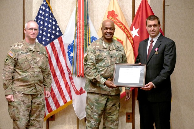 Daniel Kolenich, executive producer of the Army Game Studio, receives the Superior Civilian Service Award presented by the Army Materiel Command's Deputy Commander, Lt. Gen. Larry Wyche.