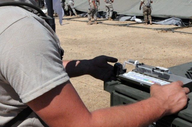 Spc. Dalton Payne, a generator mechanic assigned to 3rd Medical Command (Deployment Support)'s 345th Combat Support Hospital out of Jacksonville, Florida, checks the wet bulb reading during Global Medic 2017 at Fort Hunter Liggett, California.  The nearly 250 Soldiers assigned to the CSH spent the first few days setting up the hospital and getting it ready to begin receiving patients.  The exercise runs 8-28 July, 2017.