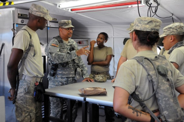 Sgt. 1st Class Reno Johnson, an Observer Coach Trainer with Medical Readiness and Training Command, speaks to the cooks assigned to 3rd Medical Command (Deployment Support)'s 345th Combat Support Hospital during Global Medic 2017 at Fort Hunter Liggett, California.  Johnson is a nutritionist focused on ensuring food preparation and planning is efficient to care for the nearly 250 Soldiers assigned to the CSH, as well as the patients with specific dietary needs.  The exercise runs 8-28 July, 2017.