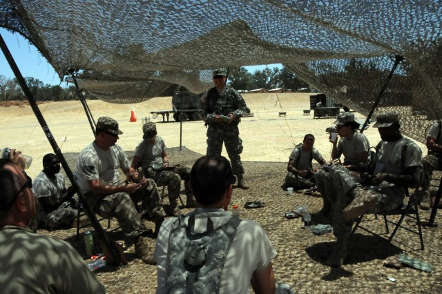 Staff Sgt. Michael Whiteley, an Observer Coach Trainer with Medical Readiness and Training Command, speaks to Soldiers assigned to 3rd Medical Command (Deployment Support)'s 345th Combat Support Hospital during Global Medic 2017 at Fort Hunter Liggett, California.  The nearly 250 Soldiers assigned to the CSH spent the first few days setting up the hospital and getting it ready to begin receiving patients.  The exercise runs 8-28 July, 2017.