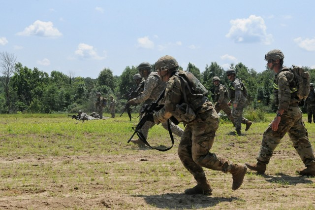 Soldiers with the 1st Battalion, 149th Infantry and 1123rd Engineer Company assault an objective with a bounding overwatch movement at Camp Atterbury, Ind., July 18, 2017. The assault was the final portion of a combined arms live-fire exercise which tested the skillsets of the infantrymen and engineers.