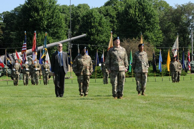 The U.S. Army Sustainment Command color guard displays the flags during the Army Sustainment Command's Change of Command Ceremony held on the Rock Island Arsenal, July 25. Col. Grant L. Morris, G3/5/7 directorate, stands in front of the troop formation.