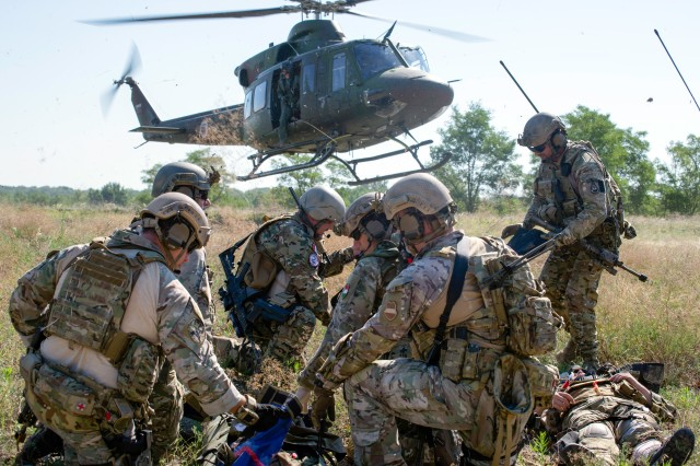 Hungarian special operations forces prepare to load a simulated casualty into a medical evacuation helicopter July 17 during exercise Black Swan in Hungary. Black Swan was a Hungarian-led special operations forces exercise from June 26 -- July 22, 2017 across locations in Bulgaria, Hungary and Romania and included participants from over eight countries. Paratroopers from the U.S. Army's 173rd Airborne Brigade and 10th Combat Aviation Brigade also participated in the exercise alongside the 20th Special Forces Group (Airborne) to improve integration between SOF and conventional forces across NATO Allies.