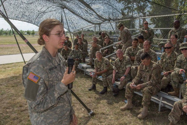 Cadet Alegra A. Van Rossum addresses 30th Medical Brigade and soldiers from partner nations during a review of what went well during Saber Guardian and what could have been improved Jul 18, 2017.
