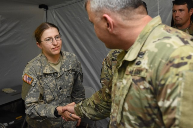 Cadet Alegra A. Van Rossum greets Brig. Gen. Timothy J. Daugherty, Deputy Chief of Staff U.S. Army Europe Jul 21, 2017.