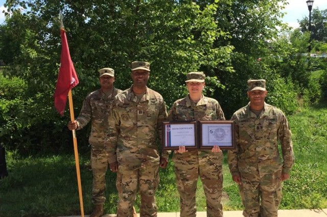 Chief Warrant Officer 3 Jacqueline Jones poses with members of the Bravo Company leadership at Fort Belvoir after receiving her Cyber Common Technical Core Course and Cyber Protection Course certifications.