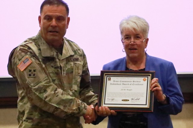 FORT CARSON, Colorado -- Maj. Gen. Ryan F. Gonsalves, commanding general, 4th Infantry Division and Fort Carson, congratulates Army Community Service Family Advocacy Program Manager Jill Nugin July 20, 2017, as she is presented with the U.S. Army Installation Management Command Army Community Service Individual Award of Excellence. (Photo by Alexandra Shea)