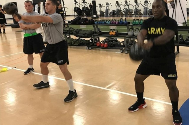 Staff Sgt. Sam Seals, right, and Spc. Matthew Vecchione, both of C Co., 1-11th Avn. Regt., compete in the second quarter Tactical Throwdown challenge.  The two tied for first place in the men's division.