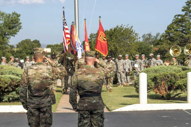 Fires Center of Excellence and Fort Sill Chief of Staff Col. Todd Wasmund and FCoE and Fort Sill Commanding General Maj. Gen. Brian McKiernan salute the flag during a reveille ceremony July 21, 2017, to welcome Wasmund as the new FCoE COS.