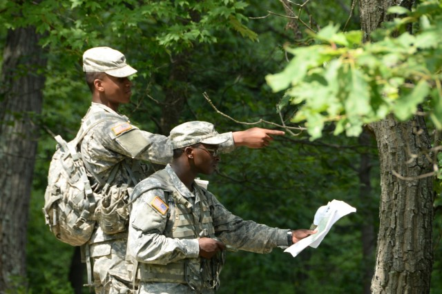 (From the Left) N.Y. Army National Guard Soldiers, Spc. Akil Bonadie, and Jerry Barry, assigned to the 427th Brigade Support Battalion, argue over where their next location is in a land navigation exercise on the Camp Smith Training Site, Cortlandt Manor, N.Y., July 16, 2017. Bonadie and Barry were being tested on her abilities in Land Nav, a necessary skill for a leader to have. The training was part of the New York Army National Guard's Future Leaders Course, a pilot program aimed at preparing Soldiers to become NCOs.