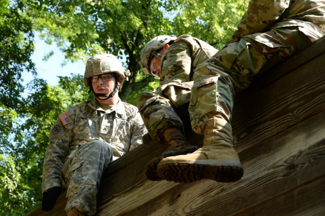 """N.Y. National Guard Soldiers, students in the Future Leader Course(FLC), complete """"The Wall"""" obstacle, from the Leader Reaction Course on the Camp Smith Training Site, Cortlandt Manor, N.Y., July 15, 2017. The Leader Reaction Course is meant to help Soldiers learn to work together as a team and control a difficult situation as a leader. The training was part of the New York Army National Guard's Future Leaders Course, a pilot program aimed at preparing Soldiers to become NCOs."""