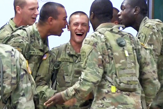 "The Soldiers imitated their drill sergeants during skits at the Warrior Meal. This hapless trainee is mobbed by ""drill sergeants."""