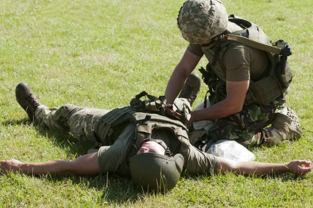 A soldier with Ukraine's 1st Battalion, 95th Separate Airmobile Brigade participates in the first entirely Ukrainian-led combat first aid course, as part of their rotational training at the Yavoriv Combat Training Center on the International Peacekeeping and Security Center near Yavoriv, Ukraine on 24 July.Yavoriv CTC OC/Ts, mentored by Soldiers from the U.S. Army's 45th Infantry Brigade Combat Team, led the training for soldiers from the 1st Battalion, 95th Separate Airmobile Brigade during the battalion's rotation through the Yavoriv CTC. The 45th is deployed to Ukraine as part of the Joint Multinational Training Group-Ukraine, an international coalition dedicated to improving the CTC's training capacity and building professionalism within the Ukrainian army. (Photo by Staff Sgt. Eric McDonough, 45th Infantry Brigade Combat Team)