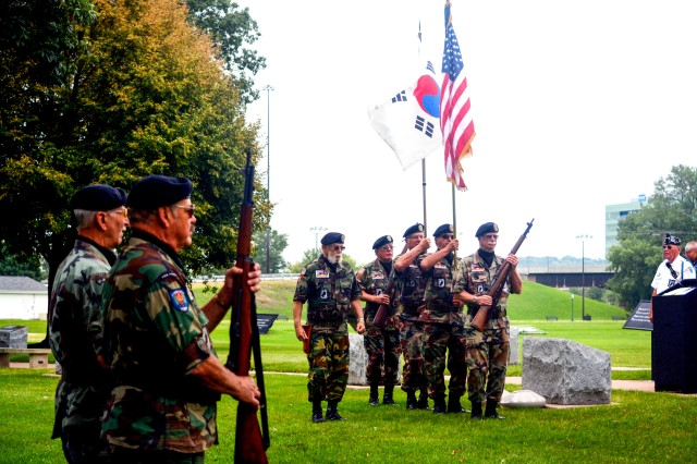 Members of the Vietnam Veterans Association Chapter 299 Color Guard, Milan, Ill., support a ceremony to honor Korean War veterans at Rock Island Arsenal National Cemetery, July 27, with a rifle salute and the playing of taps.