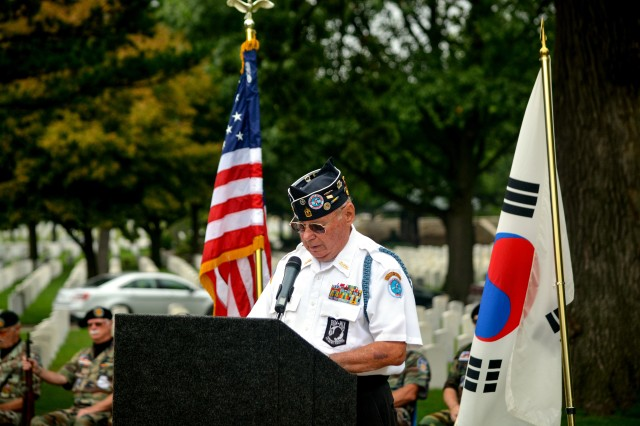 Ron Sears, president, Quad Cities Chapter #168 of the Korean War Veterans Association, delivers opening remarks during a ceremony to honor Korean War veterans at Rock Island Arsenal National Cemetery, July 27.