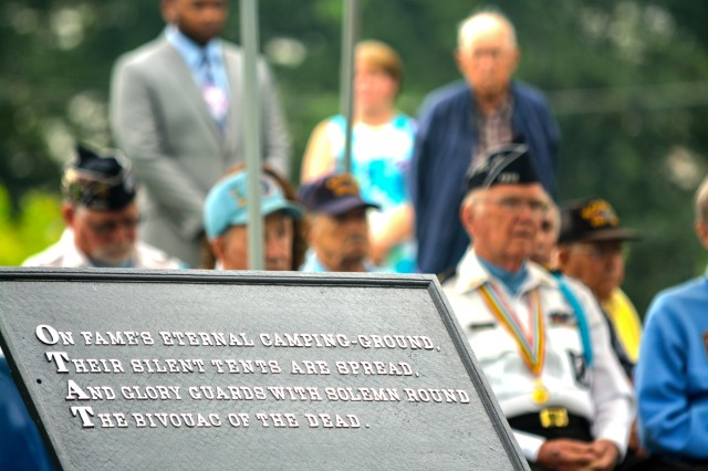Korean War veterans listen to Maj. Gen. Duane Gamble, commander, U.S. Army Sustainment Command, speak during a ceremony to honor Korean War veterans at Rock Island Arsenal National Cemetery, July 27.