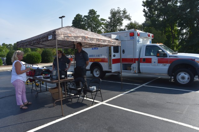 A Fort Bragg ambulance is on display in the parking lot at Womack Army Medical Center as part of the Army Medicine celebration, July 27. (U.S. Army photo by Sameria Zavala/WAMC PAO)