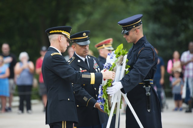 Chaplain (Maj. Gen.) Paul K. Hurley, chief of chaplains, and Regimental Sgt. Maj. Ralph Martinez, U.S. Army Chaplain Corps lay a wreath at Tomb of the Unknown Soldier in honor of the 242nd Anniversary at Arlington National Cemetery, July 28, 2017.