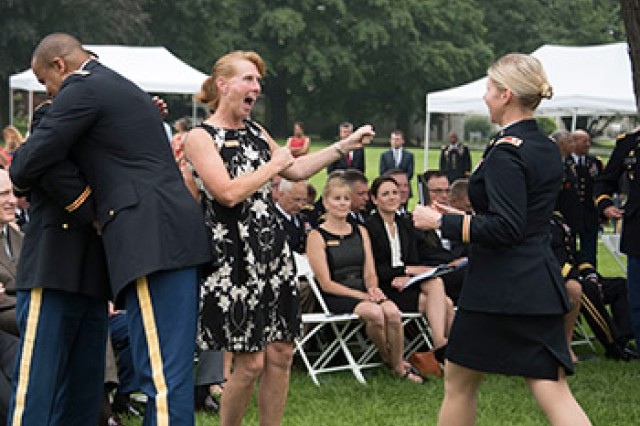Christine Stark, Army War College Distance Education Program faculty member, congratulates one of her students after she received her Masters diploma. Each student was part of a seminar learning from their faculty members, fellow students and guest speakers during virtual and residence courses.