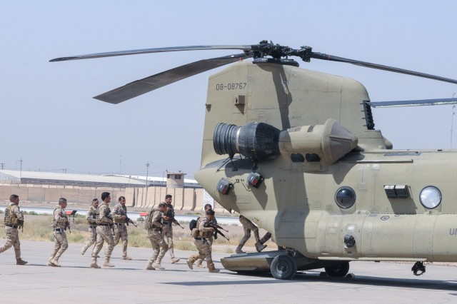 CAMP TAJI MILITARY COMPLEX, Iraq - Members of the Iraqi security force load onto a CH-47F Chinook helicopter fielded by the 29th Combat Aviation Brigade at Camp Taji Military Complex, Iraq, July 19,2017. The ISF trained with their U.S. counterparts in the 82nd Airborne Division's Task Force Red Falcon and the 29th CAB on security procedures involving aircraft and met to schedule future partnership events. This training is part of the overall Combined Joint Task Force - Operation Inherent Resolve building partner capacity mission by training and improving the capability of partnered forces fighting ISIS. CJTF-OIR is the global Coalition to defeat ISIS in Iraq and Syria. (U.S. Army photo by Capt. Stephen James)