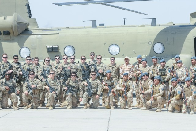 CAMP TAJI MILITARY COMPLEX, Iraq - U.S. Army Soldiers from the 29th Combat Aviation Brigade and Task Force Red Falcon's Company C, 1st Battalion, 325th Airborne Infantry Regiment, 2nd Brigade Combat Team, 82nd Airborne Division, pose in front of a CH-47F Chinook helicopter with their Iraqi counterparts following joint training at Camp Taji Military Complex, Iraq, July 19,2017. This training is part of the overall Combined Joint Task Force - Operation Inherent Resolve building partner capacity mission by training and improving the capability of partnered forces fighting ISIS. CJTF-OIR is the global Coalition to defeat ISIS in Iraq and Syria. (U.S. Army photo by Capt. Stephen James)