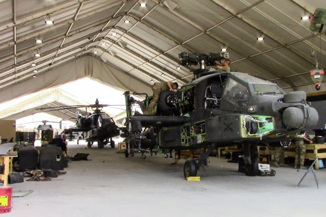 "CAMP TAJI MILITARY COMPLEX, Iraq - Army National Guard Soldiers of the 449th Aviation Support Battalion, organized under the 29th Combat Aviation Brigade, and the 1107th Theater Aviation Sustainment Maintenance Group work together on the 500-hour Phase Maintenance cycle of the AH-64E Apache ""Guardian"" at Camp Taji Military Complex, Iraq, July 6, 2017.  Proper maintenance ensures that the AH-64E Apache continues to provide reconnaissance and attack capability in the fight against ISIS for Combined Joint Task Force - Operation Inherent Resolve. CJTF-OIR is the global Coalition to defeat ISIS in Syria and Iraq."