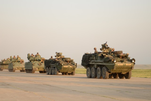 VAZIANO MILITARY BASE, Georgia - U.S. military assets such as multiple M1A2 Abrams tanks, M2 Bradley infantry fighting vehicles and M777 Howitzers arrive to where the opening ceremony for Exercise Noble Partner will occur, July 29. The vehicles must be staged in advance for the rehearsals and ceremony. Noble Partner is a bilateral, U.S. European Command-directed exercise conducting home station training for the Georgian light infantry company designated for the NATO Response Force. (U.S. Army photo by Sgt. Shiloh Capers)