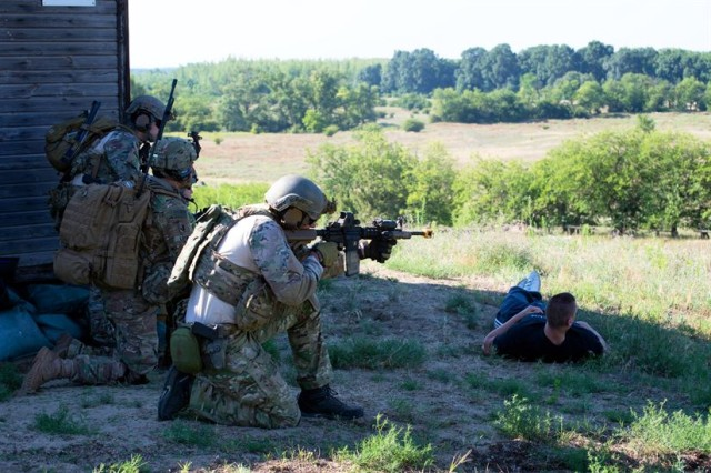 Hungarian special operations forces and paratroopers from the U.S. Army's 173rd Airborne Brigade engage an enemy quick reaction force July 17 during exercise Black Swan in Hungary. Black Swan was a Hungarian-led special operations forces exercise from June 26 -- July 22, 2017 across locations in Bulgaria, Hungary and Romania and included participants from over eight countries. Paratroopers from the U.S. Army's 173rd Airborne Brigade and 10th Combat Aviation Brigade also participated in the exercise alongside the 20th Special Forces Group (Airborne) to improve integration between SOF and conventional forces across NATO allies.
