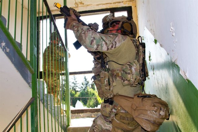 U.S. Army Special Forces Soldiers clear a stairwell during an assault July 19 during exercise Black Swan in Hungary. Black Swan was a Hungarian-led special operations forces exercise from June 26 -- July 22, 2017 across locations in Bulgaria, Hungary and Romania and included participants from over eight countries. Paratroopers from the U.S. Army's 173rd Airborne Brigade and 10th Combat Aviation Brigade also participated in the exercise alongside the 20th Special Forces Group (Airborne) to improve integration between SOF and conventional forces across NATO allies.